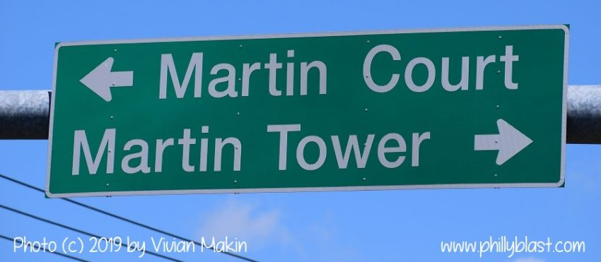 The traffic light sign at 8th Avenue still points to Martin Tower