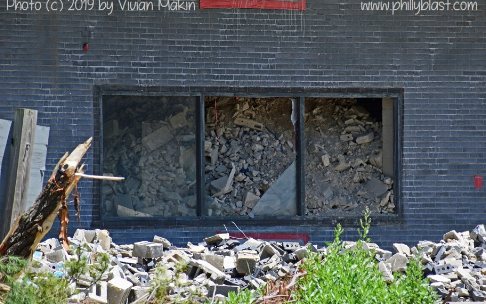 Close-up of debris filling windows of the former Martin Tower subterranean parking garage