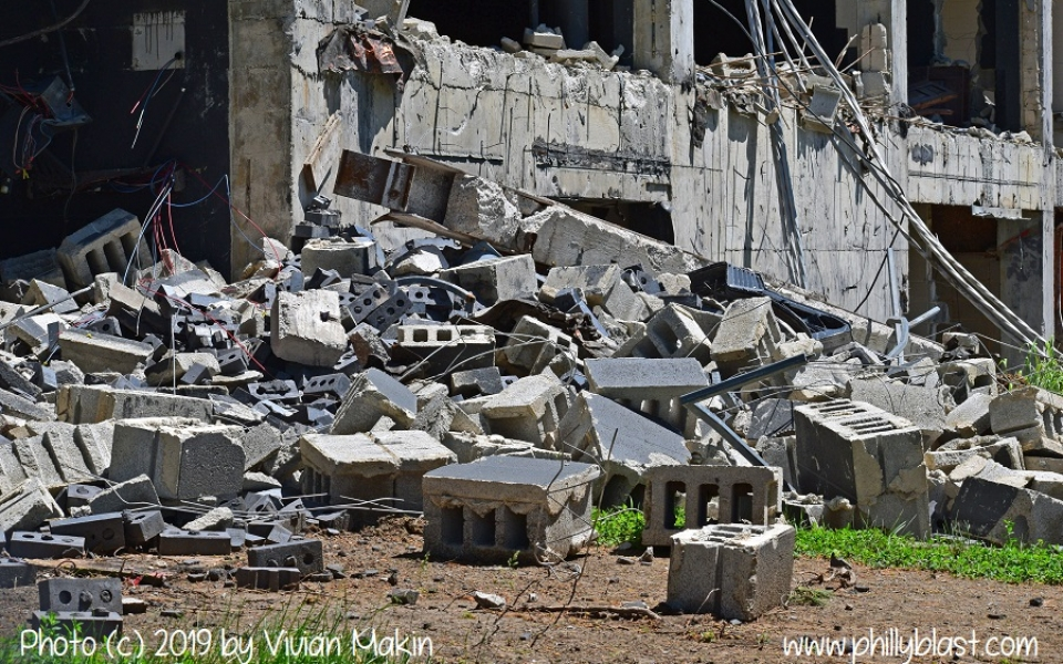 Pile of dislodged cinder blocks around the base of the demolished Martin Tower