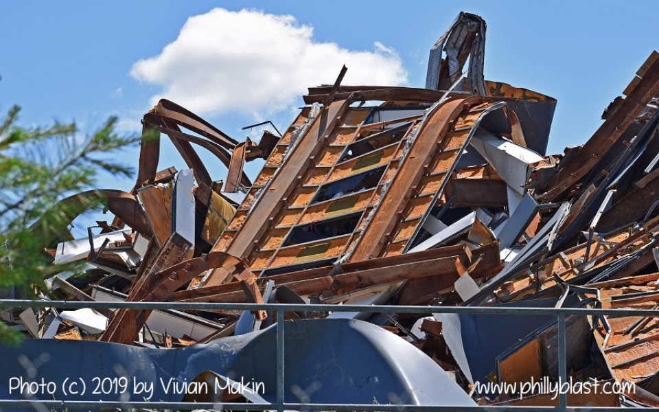 The inside of a urethane-lined exterior panel sits atop the north side of the Martin Tower debris pile
